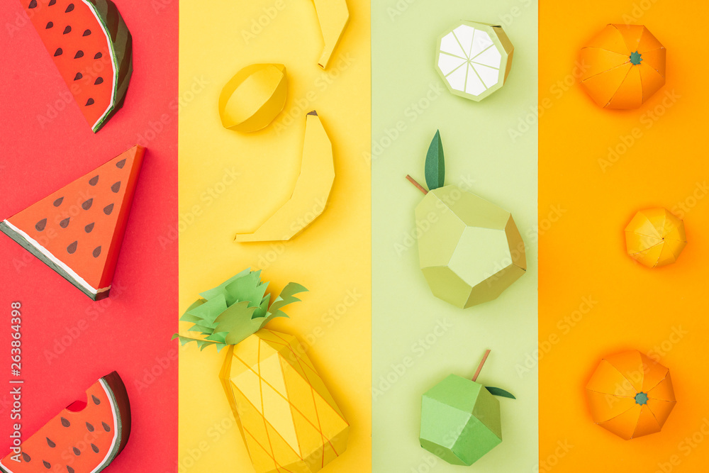Fototapety, obrazy: top view of various handmade origami fruits on multicolored paper stripes