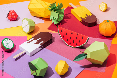 origami ice cream and handmade cardboard fruits on multicolored paper - 263866340