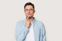 Thoughtful Man In Glasses Isolated On Grey Background Thinking
