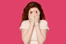 Scared Redhead Girl Cover Face...
