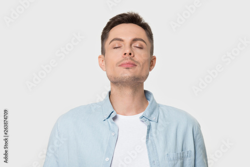 Fototapeta Calm Caucasian man breath deep enjoying pleasant smell obraz