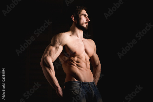 Portrait of shirtless muscular man in a jeans Wallpaper Mural