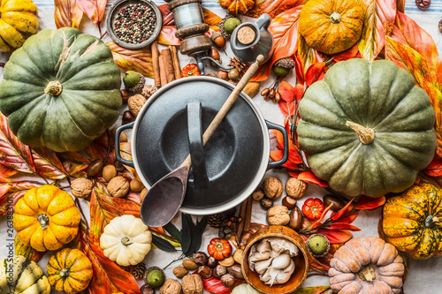 Obraz Pumpkins and pot with wooden spoon - fototapety do salonu