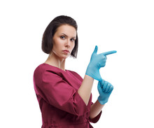 European Woman Doctor In Medical Gloves. Woman Superman, Glove Gun. Close-up Portrait On A White Background. Isolate
