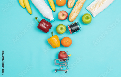 Pinturas sobre lienzo  Grocery shopping products falling into a trolley