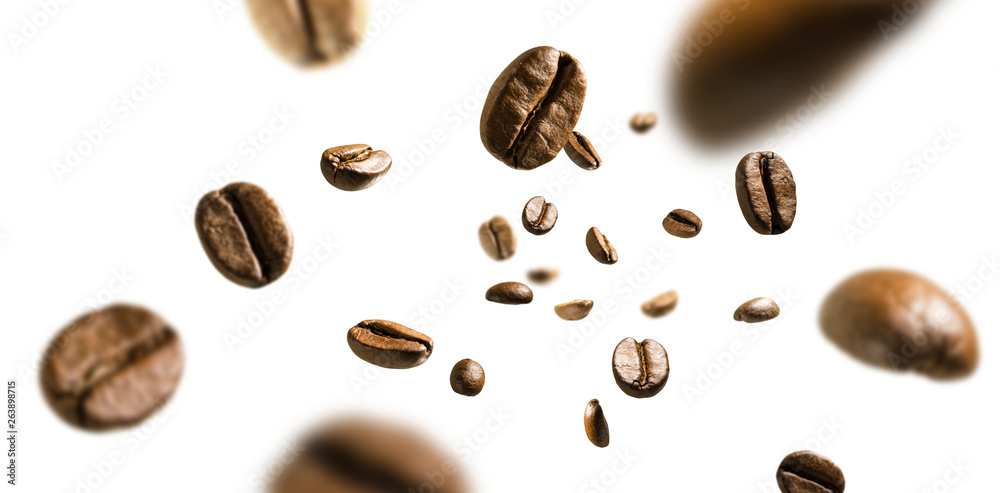 Fototapeta Coffee beans in flight on white background