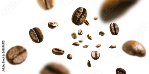 Fotografering Coffee beans in flight on white background