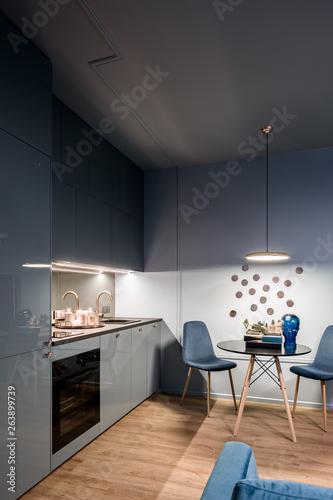 Fototapeta Dark home interior with kitchen obraz