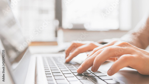 Obraz Distance education. Online college training. Remote student learning. Closeup of hands typing on laptop. - fototapety do salonu