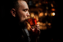 Portrait Of Bartender Sipping ...