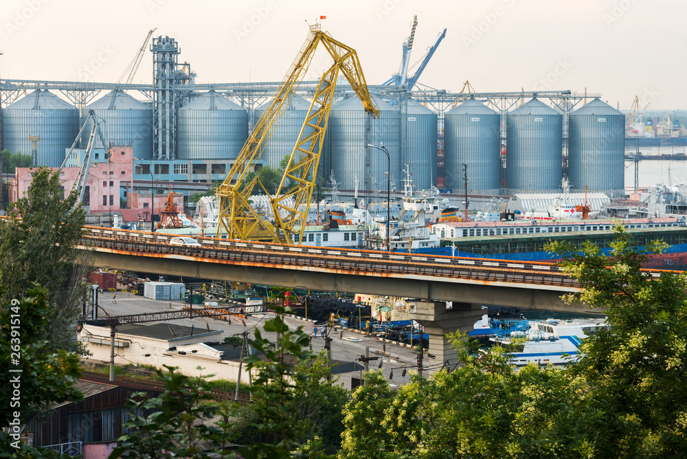 Fototapety, obrazy: a granary in the port is a marine shipping port in the city of ODESSA, Ukraine. Cranes unloading and loading