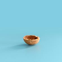 Half Walnut Shell On Blue Background