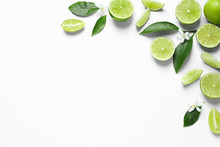 Frame Made Of Limes, Flowers And Leaves On White Background, Top View With Space For Text. Citrus Fruits