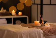 Burning Candles And Aromatic Reed Freshener On Table In Spa Salon, Space For Text