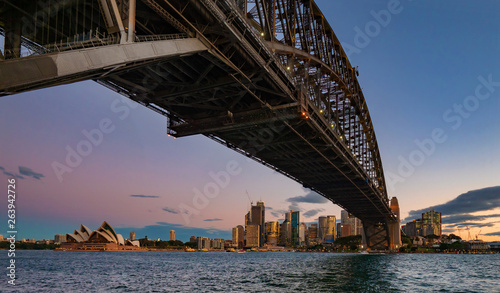 View towards Sydney from under the Harbour Bridge at sunset © thakala