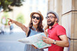 Leinwandbild Motiv Young couple visiting European city on vacation