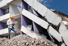 Engineer Holding Laptop Is Checking For Destruction, Demolishing Building.