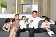 Parents Child Family father mother daughter son sit on sofa watching television entertainment