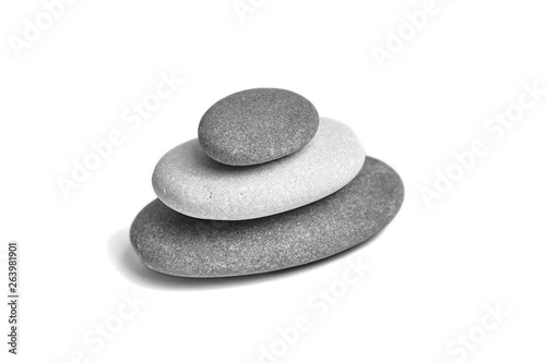 Garden Poster Spa Sea pebble. Group of smooth grey and black stones. Pebbles isolated on white background