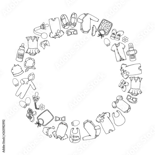 Valokuva Vector black and white illustration of baby clothes and accessories framed in circle