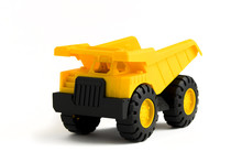 Yellow Plastic  Dump Truck Toy On White Background