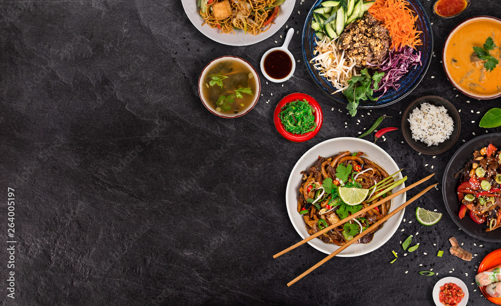 Fototapeta Asian food background with various ingredients on rustic stone background , top view.
