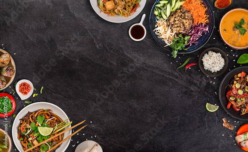 Leinwand Poster Asian food background with various ingredients on rustic stone background , top view