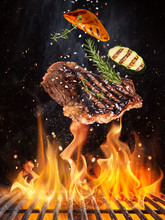 Tasty Beef Steaks Flying Above...