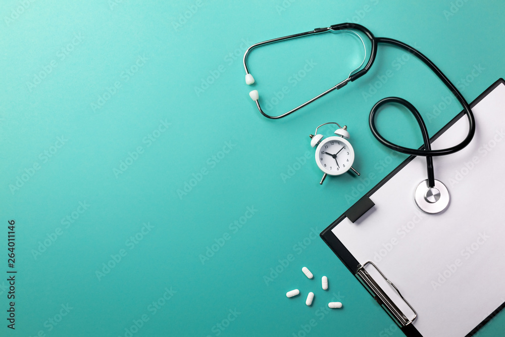Fototapety, obrazy: Stethoscope in doctors desk with tablet, pen and pills