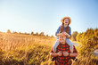 happy father and daughter walking on summer meadow, having fun and playing. Father's day, fatherhood concept. Rural living.