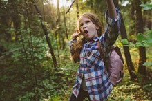 Happy Kid Girl Playing In Summer Forest With Bow And Arrows Made From Sticks