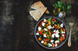 Middle Eastern cuisine. Vegetable salad with feta and parsley. Bright nutritious salad with feta vegetables and pita.