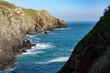 stone ocean coast and blue sky