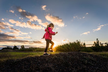 Child Climbs Pile Of Stones At...