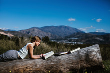 Young Girl Studies In The Field In Spring