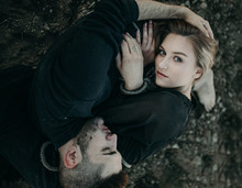 Young Couple In Love Laying On The Ground