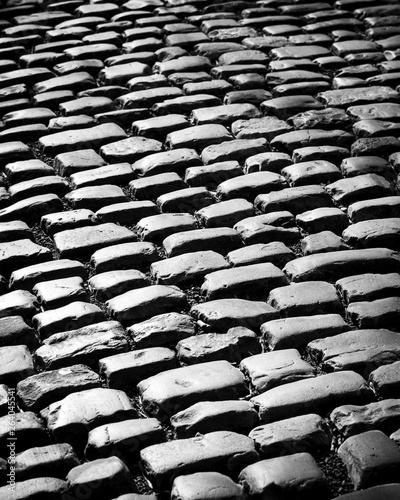 Fotografía  Old pavement tiles in black and white
