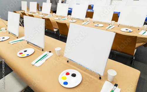 Multiple blank canvas with paint setup for art class