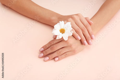Wall Murals Pedicure Closeup view of woman with flower on color background. Spa treatment