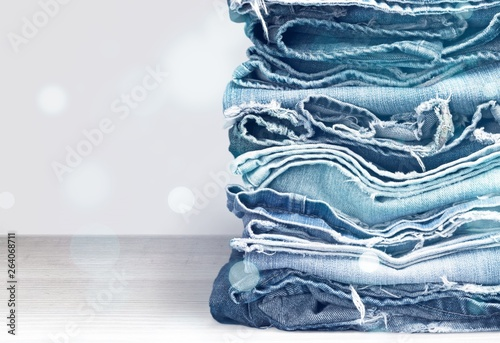 Fotografia  Stack of jeans clothes on background