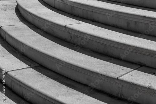 Close view of grey granite stairs, curved architectural
