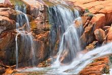 Views Of Waterfalls At Gunlock State Park Reservoir Falls, In Gunlock, Utah By St George. Spring Run Off Over Desert Erosion Sandstone. United States.