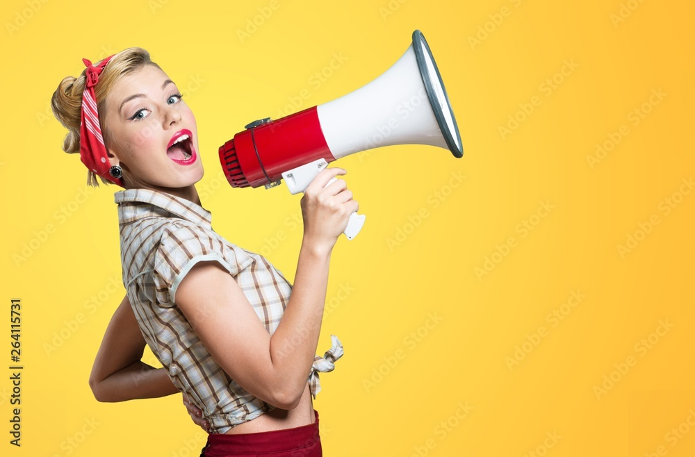 Fototapety, obrazy: Portrait of woman holding megaphone, dressed in pin-up style