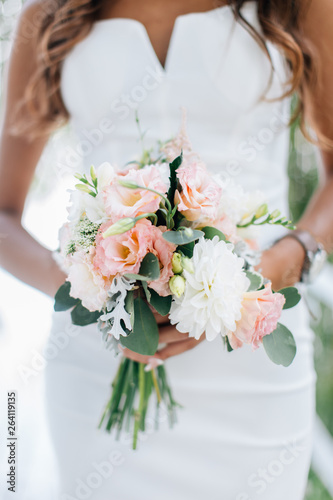 Bride in white dress holding bouquet