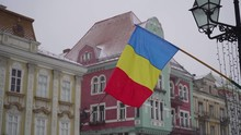 Romanian Flag In Slow Motion In Snow