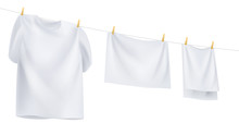 White Clothes Hanging On The R...