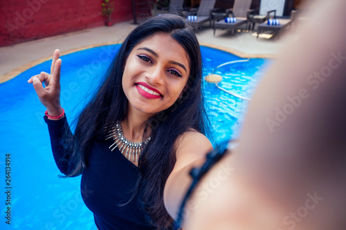 Canvas Print beautiful indian woman toothy white smile selfie portrait on smartphone camera s