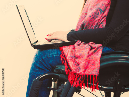 Foto  Crippled person with laptop