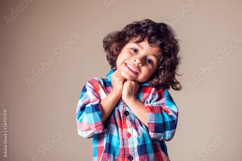 Fotografía  Portrait of a cute little smiling boy. Children, emotions concept