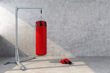 Red Punching Bag With A Concre...